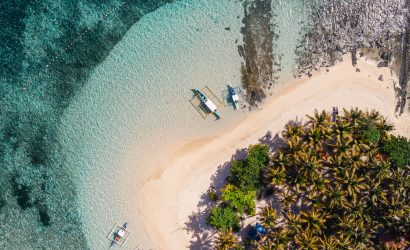 Drone shot of the beach and boats in the small island of Guyam, in the Philippines